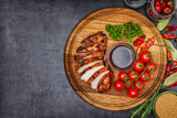 whole and sliced chicken breast with spices on a stone board, top view copy - 221747787