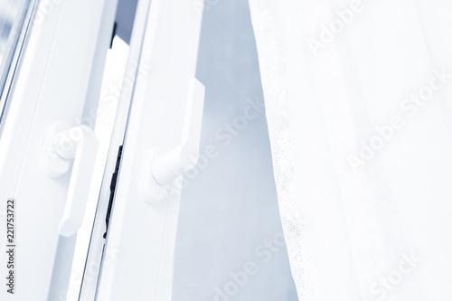 Double glazed window. Closeup on handle - 221753722