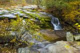 Stream Running Through Backwoods Of Pennsylvania During Fall Season