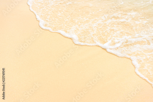 Leinwandbild Motiv Soft bubble wave on sandy beach.