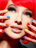Closeup face of a beautiful  girl with  multicolor nails. - 221770506