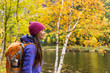 Leinwanddruck Bild - Woman hiker hiking looking at scenic view of fall foliage mountain landscape . Adventure travel outdoors person standing relaxing near river during nature hike in autumn season.