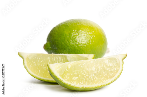 lime and  two slices  isolated on white background - 221777367