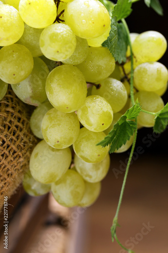 organic white green grapes on a wooden background