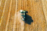 Shooting from above, combine harvester works on a wheat field. - 221780798