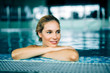 canvas print picture - Portrait of beautiful woman relaxing in swimming pool