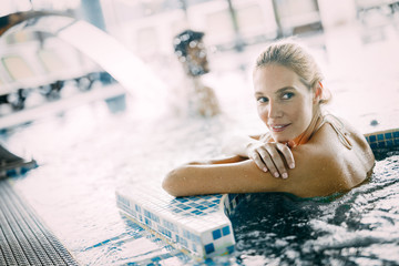Portrait of beautiful woman relaxing in swimming pool © nd3000