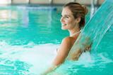 Portrait of beautiful woman relaxing in swimming pool - 221781948