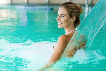 Portrait of beautiful woman relaxing in swimming pool