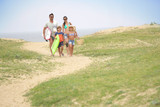 Family walking to the beach, sand dune path