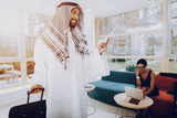 Arabian Businessman Holding A Tickets In Office. - 221788551