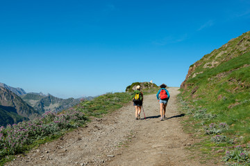 two women hiker on mountain trail in the Pyrenees