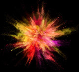 Explosion of coloured powder isolated on black background. - 221789392