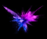Explosion of coloured powder isolated on black background. - 221790163