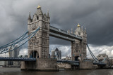 Tower bridge, over the river Thames, London, on a cloudy, stormy day  - 221790383