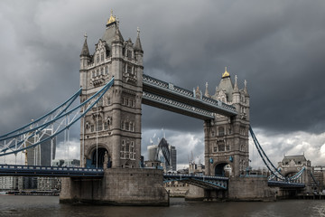 Tower bridge, over the river Thames, London, on a cloudy, stormy day  © bridgendboy