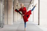 Woman ballerina dance with umbrella in city