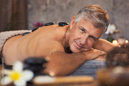 Leinwanddruck Bild Senior man at beauty spa