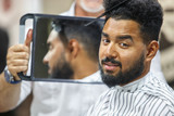 Young black man client get new haircut in barbershop
