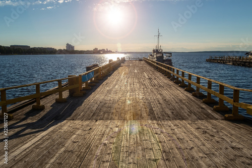 Wooden pier on the background of the sea
