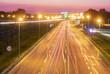 light trails on motorway highway at night, long exposure - 221807360