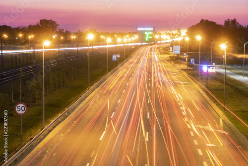 light trails on motorway highway at night, long exposure