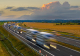 evening traffic of cars on the highway - 221808389