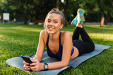 Portrait of a cheerful young fitness girl