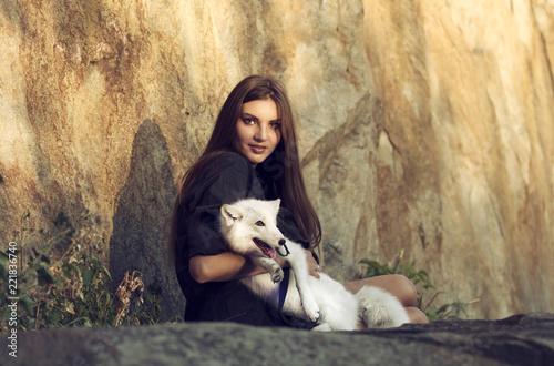 Fototapeta girl and polar fox together
