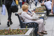 Moscow, Russia - September, 10, 2018: seniors sit on a bench on the Moscow street Kuznetsky most