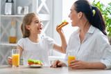 Happy family having breakfast. - 221839108