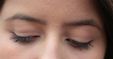 Close-up of thoughtful girl eyes looking down. Change of emotion - 221840534