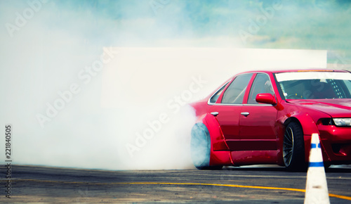 Diffusion race drift car with lots of smoke from burning tires on speed track