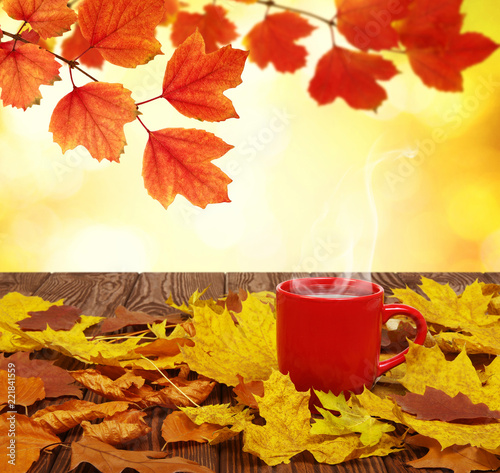 Autumn leaves and hot steaming cup of coffee. - 221841559