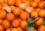 Juicy organic tangerines at  farmer market stall. Natural vitamin C concept.