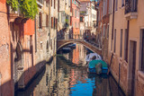 boats in narrow canals in Venice, Italy - 221850734