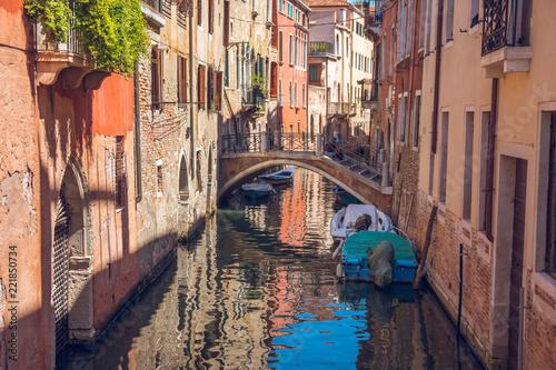 Fototapeta boats in narrow canals in Venice, Italy