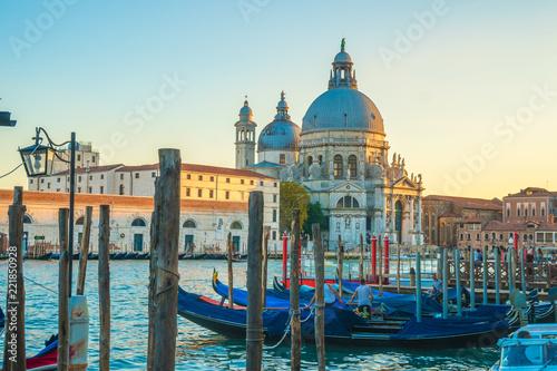 Beautiful view of traditional Gondolas on Canal Grande with historic Basilica di Santa Maria della Salute in Venice, Italy - 221850928