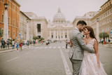 Young wedding couple by Saint Peter cathedral in Vatican - 221851963