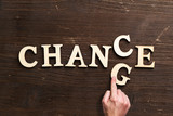 Hand changes one of six letters, turning the word