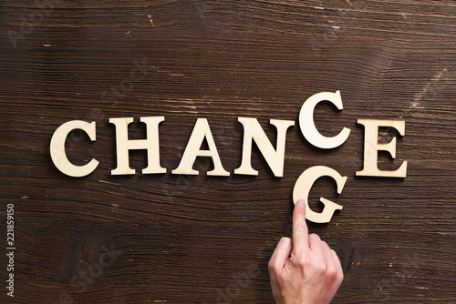 """Leinwanddruck Bild Hand changes one of six letters, turning the word """"change"""" to """"chance"""""""
