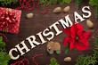 """Leinwandbild Motiv sweet decoration and the word """"christmas"""" on wooden background"""