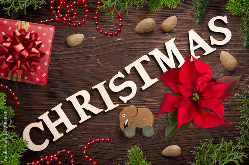 "Leinwanddruck Bild sweet decoration and the word ""christmas"" on wooden background"
