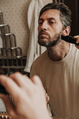 Haircut with gray hair trimmer