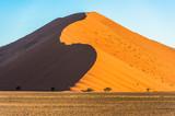 Red dunes in Sossusvlei, Namib-Naukluft National Park, Namibia - 221867570