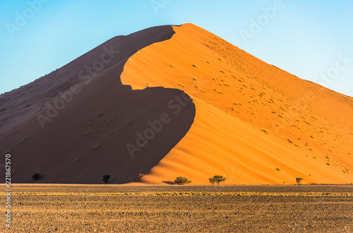 Red dunes in Sossusvlei, Namib-Naukluft National Park, Namibia - 221867570