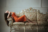 Woman with long healthy hair relax on sofa. Your hair is our best advert