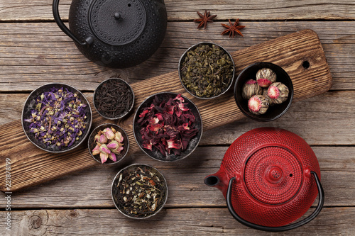 Various tea and teapot. Black, green and red tea - 221878199