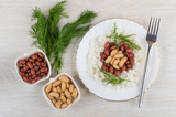 Beans with rice, bowls with red and white beans, dill - 221881939