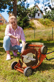Person having problem with land mower - 221888976
